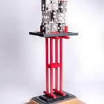 Andy Libertone; Table Dance with Red Legs; Powder-coated steel; 82x24x14.5 -