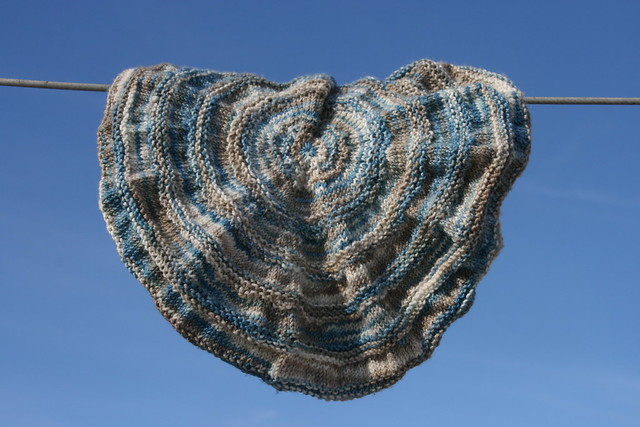 Ripple Hat knit out of Destination Yarn colorway Frozen Great Lake