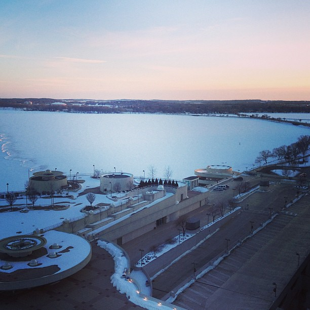 A view of the frozen snow covered lake in Madison,WI. We love it here!! You can't see them but there are ice fishers on the other side.