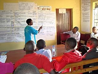 Participant presenting a community action plan in Birere, Uganda