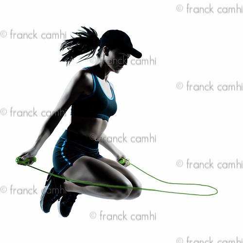 woman runner jogger jumping rope