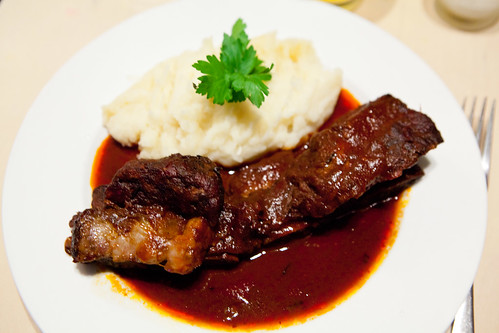 Braised short ribs in ancho chile and guava sauce, served with mashed potatoes