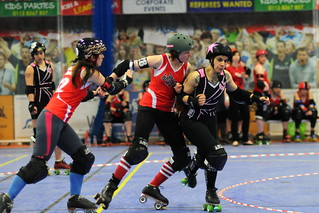 The muscular Saints jammer running past a pair of Roses blockers