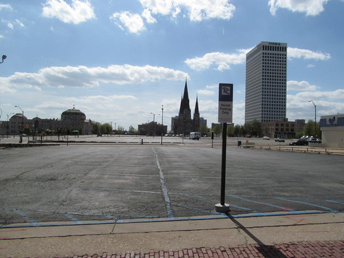 Looking west across the parking crater from Cincinnati between 8th and 9th toward 1st Christian Church and Holy Family Cathedral (SX002831)
