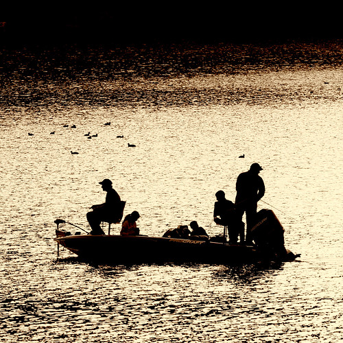 family sunset lake boat fishing silhouettes crew rod recreation motorboat sportsman reel boatingsafety procraft img985021