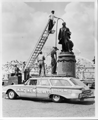Cleaning Seward statue at Volunteer Park, 1961