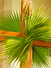 A cross decorated with palm branches