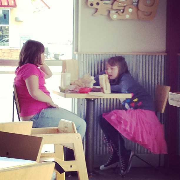 Now that she's 11, she'd rather dine with her BFF across the restaurant from the parents