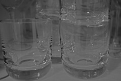 wine glass(0.0), glass bottle(0.0), stemware(0.0), bottle(0.0), old fashioned glass(1.0), drinkware(1.0), tableware(1.0), highball glass(1.0), glass(1.0), black-and-white(1.0),