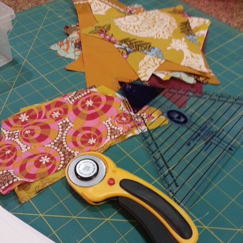 Spent the evening cutting gold/brown fabrics for patchwork prism quilt