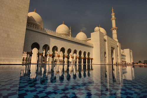 city travel sky white reflection building tower art tourism beach water architecture modern religious temple gold town worship dubai day exterior view place outdoor minaret islam united traditional prayer religion uae culture grand landmark mosque tourist arabic east holy emirates zayed abudhabi arab dome marble arabian oriental middle abu dhabi sheikh unitedarabemirates largest islamic canon1740l bobbyaycock