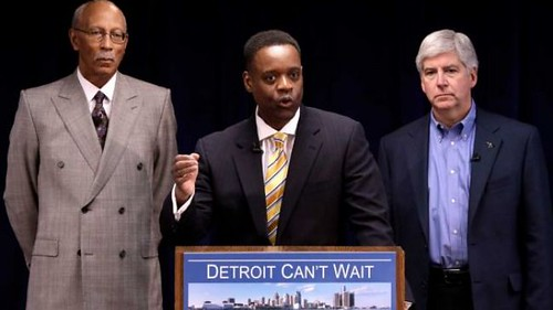 Black fascist corporate agents David Bing, Kevyn Orr and their white overseer Rick Snyder. The banks are enslaving Detroit to seize public assets and pension funds to gamble away on Wall Street. by Pan-African News Wire File Photos