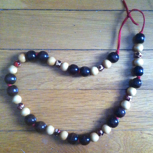 Necklace with Wooden Beads on Red Suede Cord by randubnick