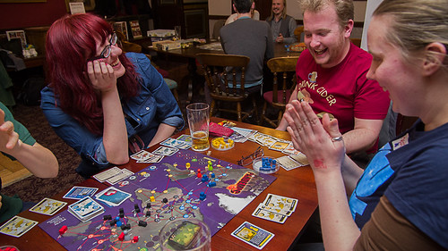 People enjoying a game of Pandemic