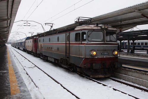 Double headed commuter train of double deck carriages arrives at Bucharest