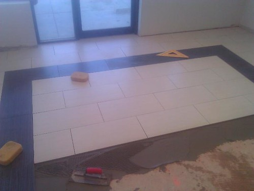 Commercial porcelain tile during progress at Spa n nail salon