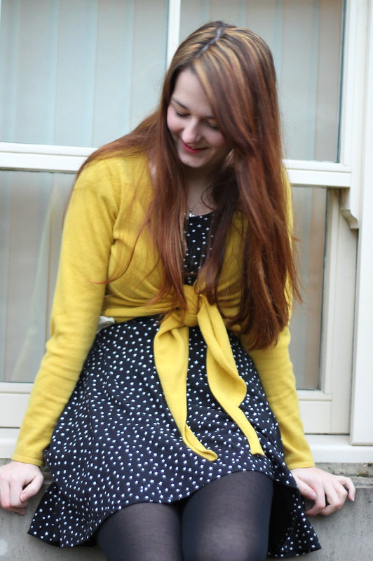 Yellow cropped cardigan, starry print dress, black shoe boots