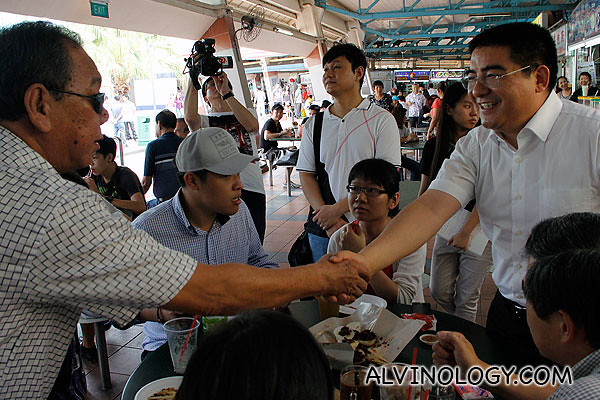 A Singaporean uncle came up to greet Chen and shook his hands, praising him for his charitable deeds