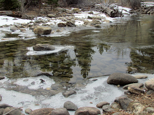 mountain snow reflection ice nature rock spring boulder melt wyoming