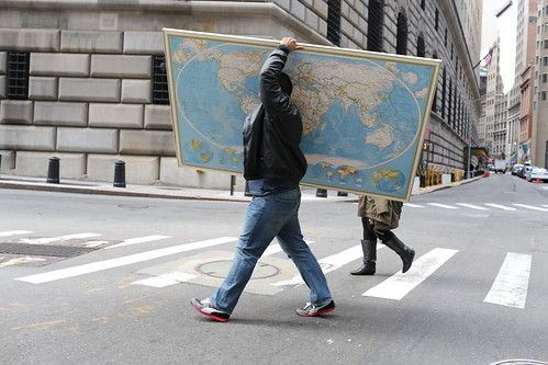 Man carrying world map
