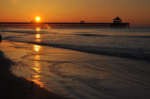 ocean sunset sun beach sunrise pier south charleston carolina folly