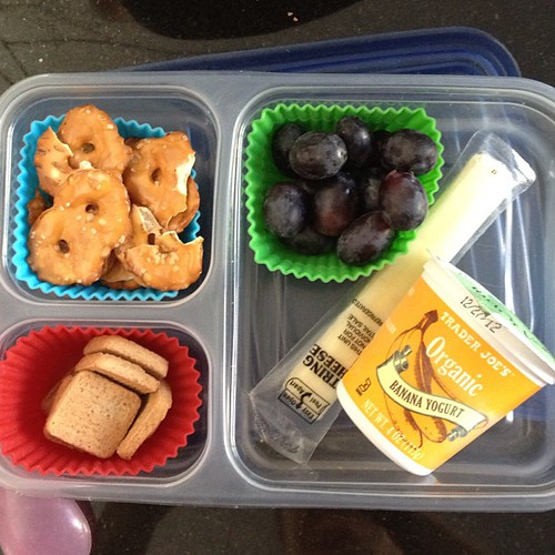 Simple lunch today - yogurt, cheese stick, grapes, pretzels and cinnamon alphabet cookies #kidslunch