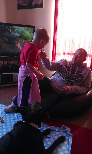 Arran in his cake baking pinny stealing daddys wispa gold by xxx zos xxx