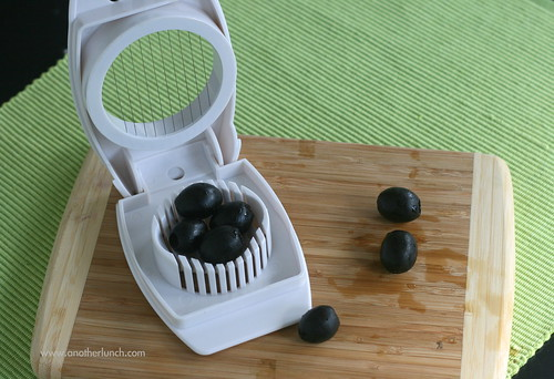 an easy way to slice olives quickly