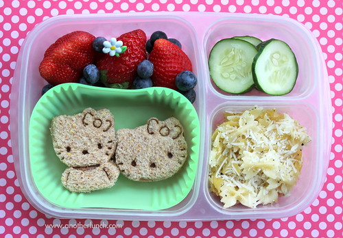 Hello Kitty sandwiches, parm pasta, berries, cucumbers in EasyLunchboxes bento lunch