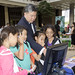 State Representative Mark Takai and young friends play a game hosted by the UH Cancer Center.