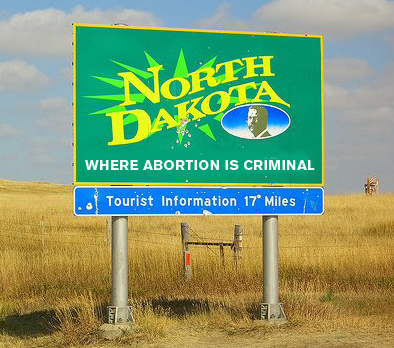 North Dakota welcome sign: Where abortion is criminal