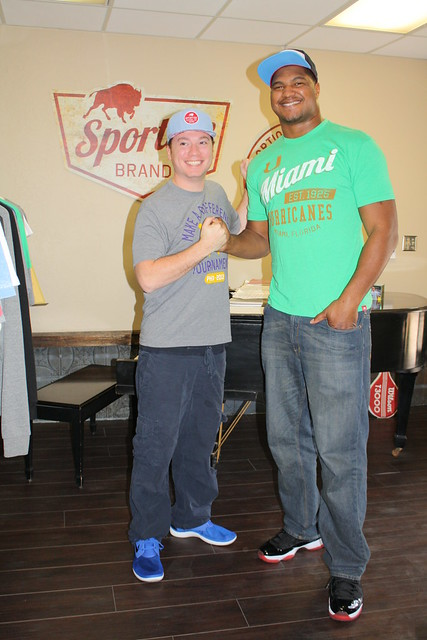 Calais Campbell with Sportiqe Apparel Co-Founder Jason Franklin