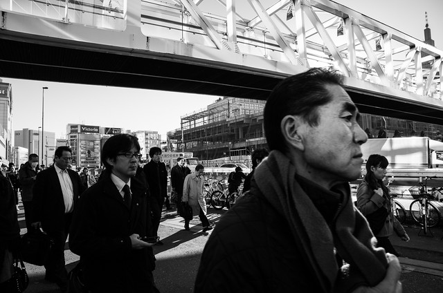 Salary men going to work in Shinjuku, Tokyo. I shot this with focus pre-set at 2.5m with the Ricoh GXR and the 24-85mm lens module, set to the 24mm end. Zone focusing is the name of the game with Ricoh cameras.