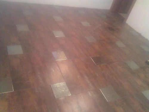 Porcelain tile with stainless steel tile