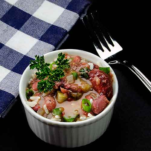 Red Beans and Rice in White Ramekin with Napkin and Fork