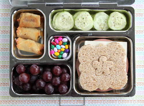 PlanetBox lunch with flower sandwich, grapes, pizza wontons