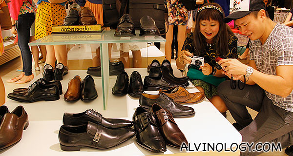 Bloggers Darren and Juliana having fun taking photos of Bata shoes