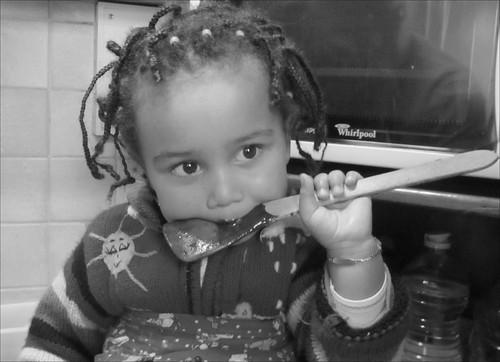 Leïla tasting a chocolate cake batter