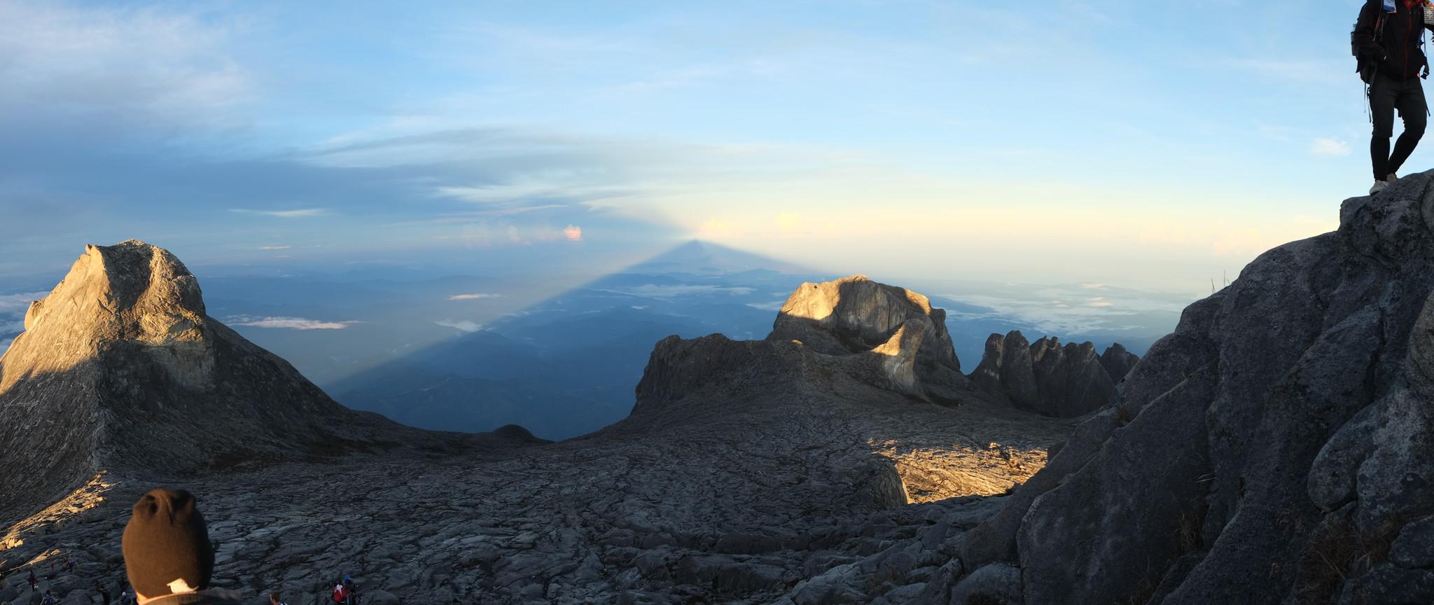 Panoramic - shadow crossing in the horizon on the dark side of Low's Peak