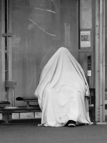 Homeless Person under Drapery