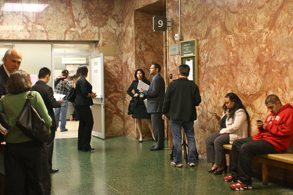 People gathered in front of the court room entrance before the arraignment of former SF State Director Robert Shearer and Chemical Hazardous Materials Technology owner Stephen Cheung at Hall of Justice on Friday April 26, 2013. Photo by Gabriella Gamboa / Xpress