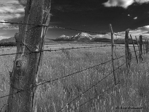 mountains sky clouds fences field landscapes availablelight handheld olympus omd em10 corel paintshoppro topaz denoise adjust clarity detail jamesclinich utah ut blackwhite bweffects monochrome