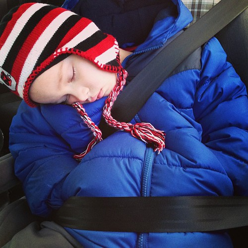 Winter car nap, with hands in pockets. Baby it's cold outside!