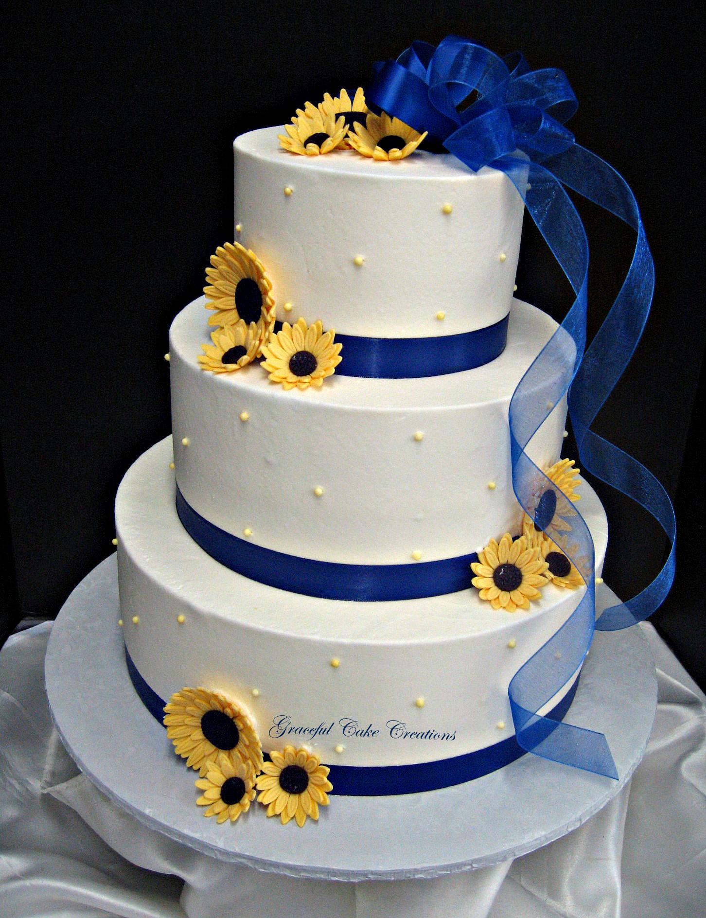 Elegant White Buttercream Wedding Cake With Royal Blue Ribbon And Yellow Daisies