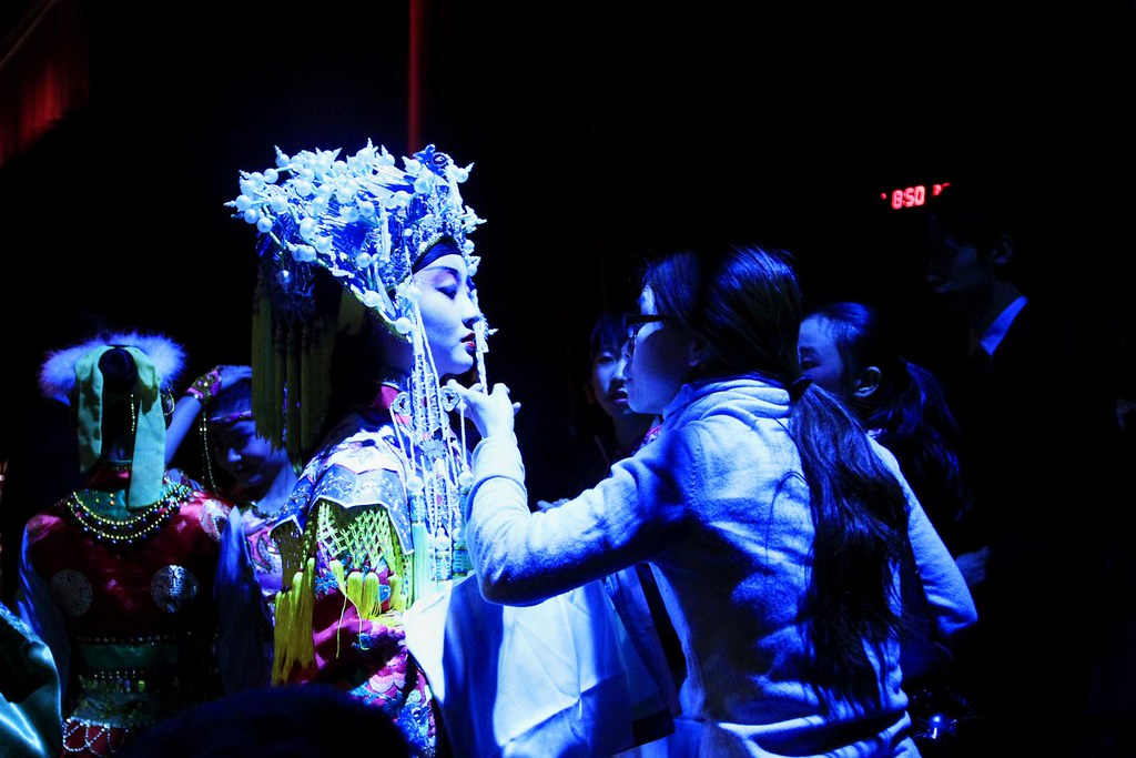 A Peking opera performer has her lipstick checked by her teacher backstage on Friday, Jan. 20, 2012 during the Chinese Culture and Art show at Jesse Hall Auditorium.