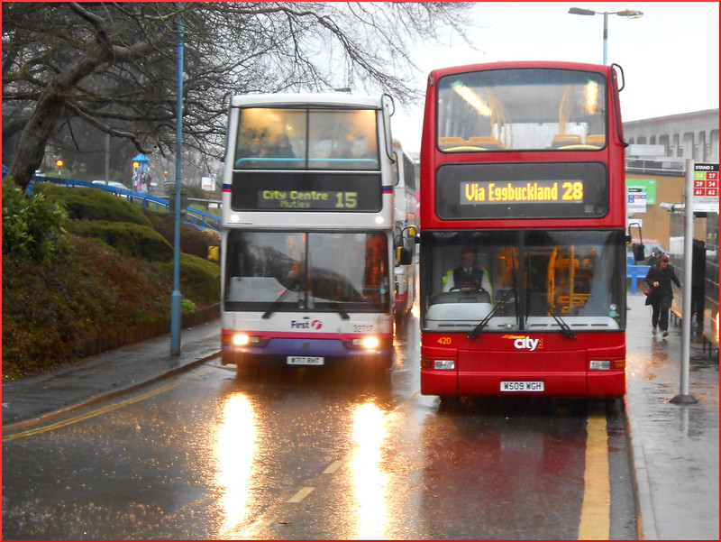 FDC Dennis Trident 32717 W717RHT passes Plymouth Citybus PVL 420 W509WGH at a very wet Derriford Hospital.