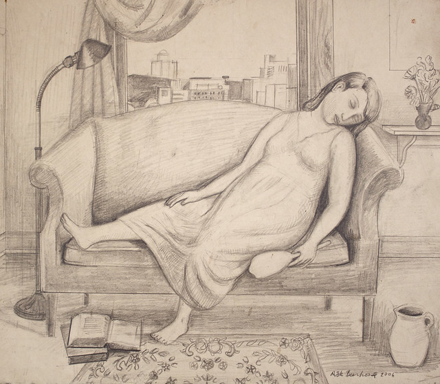 girl sleeping on couch holding a mirror