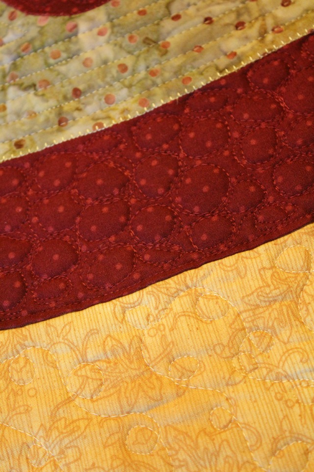 Persian Pickles table topper quilting detail