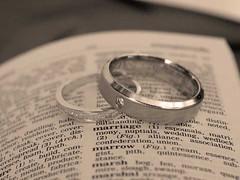 hand(0.0), brand(0.0), wedding ceremony supply(1.0), ring(1.0), jewellery(1.0), close-up(1.0), silver(1.0), platinum(1.0), circle(1.0), wedding ring(1.0),