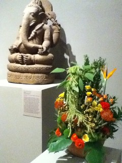 Ganesh statue with flower arrangement